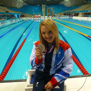 Charlotte Henshaw poolside with medals_600
